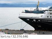 Passenger Expedition Passenger Cruise Liner Azamara Quest anchored at pier Sea Port Petropavlovsk-Kamchatsky City. Pacific Ocean, Kamchatka Peninsula (2019 год). Редакционное фото, фотограф А. А. Пирагис / Фотобанк Лори