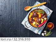 Купить «overhead view of Jamaican spicy Curry Goat», фото № 32316910, снято 1 июля 2019 г. (c) Oksana Zh / Фотобанк Лори