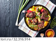 Купить «overhead view of Jamaican spicy Curry Goat», фото № 32316914, снято 1 июля 2019 г. (c) Oksana Zh / Фотобанк Лори