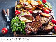 Купить «close-up of Grilled Pork Chops with potatoes», фото № 32317086, снято 19 июля 2019 г. (c) Oksana Zh / Фотобанк Лори