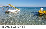 Купить «Protaras, Cyprus - Oct 12. 2019. People swim in the sea at the Famous Sunrise Beach», видеоролик № 32317458, снято 20 октября 2019 г. (c) Володина Ольга / Фотобанк Лори