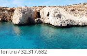 Купить «View from the sea to Caves in Cavo Greco in Protaras, Cyprus», видеоролик № 32317682, снято 21 октября 2019 г. (c) Володина Ольга / Фотобанк Лори