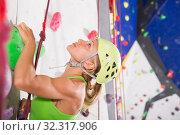Купить «Woman in climbing outfit training at bouldering gym», фото № 32317906, снято 9 июля 2018 г. (c) Яков Филимонов / Фотобанк Лори