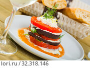 Купить «Roasted grill slices of eggplant and tomato», фото № 32318146, снято 17 февраля 2020 г. (c) Яков Филимонов / Фотобанк Лори