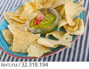 Купить «Corn chips nachos on plate with homemade guacamole sauce», фото № 32318194, снято 3 апреля 2020 г. (c) Яков Филимонов / Фотобанк Лори