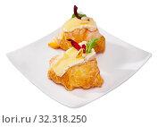 Купить «Camembert cheese on a mini croissant, french dessert at plate», фото № 32318250, снято 16 июля 2020 г. (c) Яков Филимонов / Фотобанк Лори
