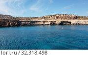 Купить «View from the sea to Cavo Greco in Protaras, Cyprus», видеоролик № 32318498, снято 21 октября 2019 г. (c) Володина Ольга / Фотобанк Лори