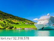 Купить «Luxury cruise liner MSC Meraviglia  In The Fjord Of Olden Norway», фото № 32318578, снято 26 мая 2020 г. (c) Николай Коржов / Фотобанк Лори