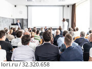 I have a question. Group of business people sitting in conference hall. Businessman raising his arm. Conference and Presentation. Business and Entrepreneurship. Стоковое фото, фотограф Matej Kastelic / Фотобанк Лори