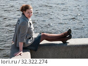 Купить «Woman dressed gray coat, jeans skirt and pantihose sitting on granite bank of river», фото № 32322274, снято 10 мая 2009 г. (c) Кекяляйнен Андрей / Фотобанк Лори