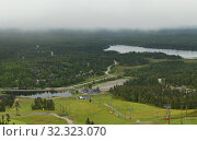 Купить «Rukatunturi (Ruka), ski resort in Kuusamo, northern hills and cableway in fog. Finland», фото № 32323070, снято 6 июля 2015 г. (c) Валерия Попова / Фотобанк Лори