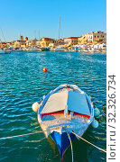 Купить «Old oar boat in the port of Aegina», фото № 32326734, снято 14 сентября 2019 г. (c) Роман Сигаев / Фотобанк Лори
