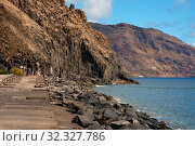 Breakwater rocky volcanic mountains and Atlantic Ocean view, Tenerife, Canary Islands, Spain (2019 год). Стоковое фото, фотограф Alexander Tihonovs / Фотобанк Лори