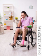 Купить «Young man suffering at home after car accident», фото № 32328126, снято 29 июля 2019 г. (c) Elnur / Фотобанк Лори
