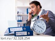 Купить «Young male accountant working in the office», фото № 32328254, снято 19 июля 2019 г. (c) Elnur / Фотобанк Лори