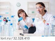 Купить «Two chemists working in the lab», фото № 32328410, снято 25 июня 2019 г. (c) Elnur / Фотобанк Лори