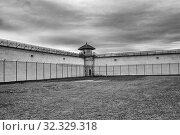 Купить «Barbed wire on a fence in prison yard Kingston Penitentiary a former maximum security prison that opened June 1835 and closed September 2013 now open for Jailhouse Tours Ontario Canada.», фото № 32329318, снято 27 августа 2019 г. (c) age Fotostock / Фотобанк Лори