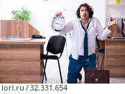 Купить «Young male employee unhappy with excessive work», фото № 32331654, снято 24 мая 2019 г. (c) Elnur / Фотобанк Лори