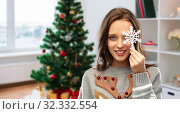 Купить «woman in christmas sweater with snowflake at home», фото № 32332554, снято 9 декабря 2018 г. (c) Syda Productions / Фотобанк Лори
