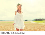 Купить «happy young woman in flower wreath on cereal field», фото № 32332662, снято 31 июля 2016 г. (c) Syda Productions / Фотобанк Лори