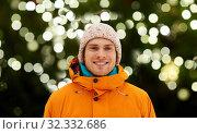 Купить «happy young man in winter clothes outdoors», фото № 32332686, снято 7 февраля 2015 г. (c) Syda Productions / Фотобанк Лори