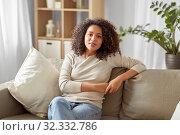 Купить «happy african american young woman at home», фото № 32332786, снято 22 сентября 2019 г. (c) Syda Productions / Фотобанк Лори