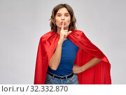 Купить «happy woman in red superhero cape», фото № 32332870, снято 30 сентября 2019 г. (c) Syda Productions / Фотобанк Лори