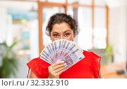 Купить «happy woman holding euro money banknotes», фото № 32332910, снято 15 сентября 2019 г. (c) Syda Productions / Фотобанк Лори