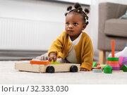 Купить «african baby girl playing with toy blocks at home», фото № 32333030, снято 29 сентября 2019 г. (c) Syda Productions / Фотобанк Лори