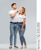 couple in white t-shirts ready for kiss. Стоковое фото, фотограф Syda Productions / Фотобанк Лори