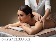 woman lying and having back massage at spa. Стоковое фото, фотограф Syda Productions / Фотобанк Лори