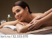 woman lying and having massage at spa. Стоковое фото, фотограф Syda Productions / Фотобанк Лори