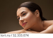 Купить «young woman lying at spa or massage parlor», фото № 32333074, снято 13 октября 2019 г. (c) Syda Productions / Фотобанк Лори
