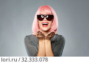Купить «happy woman in pink wig holding something on palms», фото № 32333078, снято 30 сентября 2019 г. (c) Syda Productions / Фотобанк Лори