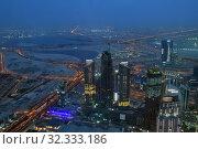 Dubai, UAE - April 8. 2018. View of skyscrapers from Burj Khalifa to city at night. Редакционное фото, фотограф Володина Ольга / Фотобанк Лори