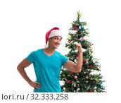 Купить «Young man decorating christmas tree isolated on white», фото № 32333258, снято 21 сентября 2017 г. (c) Elnur / Фотобанк Лори