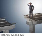 Купить «Businessman ready to overcome the broken bridge», фото № 32333322, снято 11 декабря 2019 г. (c) Elnur / Фотобанк Лори