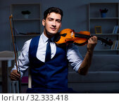 Купить «Young musician man practicing playing violin at home», фото № 32333418, снято 15 августа 2017 г. (c) Elnur / Фотобанк Лори