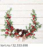 Купить «Christmas wreath on white wooden backdrop», фото № 32333698, снято 21 октября 2019 г. (c) Майя Крученкова / Фотобанк Лори
