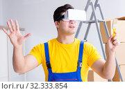 Купить «The painter contractor working with virtual reality goggles», фото № 32333854, снято 23 мая 2017 г. (c) Elnur / Фотобанк Лори
