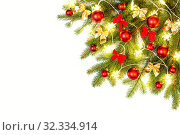 Christmas composition of fresh spruce branches decorated with red Christmas baubles, bows and snowflakes lights. Стоковое фото, фотограф Юлия Бабкина / Фотобанк Лори
