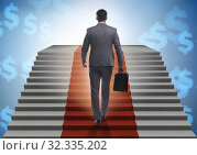 Купить «Young businessman climbing stairs and red carpet», фото № 32335202, снято 29 февраля 2020 г. (c) Elnur / Фотобанк Лори