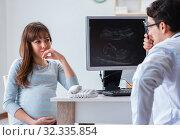 Купить «The pregnant woman visiting doctor for regular check-up», фото № 32335854, снято 3 ноября 2017 г. (c) Elnur / Фотобанк Лори
