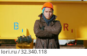 A man worker put on an orange helmet and posing. Стоковое видео, видеограф Константин Шишкин / Фотобанк Лори