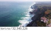 Купить «Scenic aerial view of rocky Atlantic coast of Cabo da Roca in sunny spring day, Portugal», видеоролик № 32340226, снято 21 апреля 2019 г. (c) Яков Филимонов / Фотобанк Лори