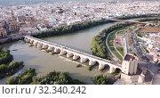 Купить «Aerial view of Historic centre of Cordoba with antique Roman Bridge over Guadalquivir river and medieval Mosque-Cathedral, Spain», видеоролик № 32340242, снято 22 апреля 2019 г. (c) Яков Филимонов / Фотобанк Лори