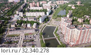 Купить «Aerial view of modern residential areas of Chekhov city in sunny spring day, Russia», видеоролик № 32340278, снято 13 мая 2019 г. (c) Яков Филимонов / Фотобанк Лори