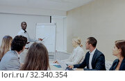 Купить «African American businessman making presentation on staff meeting at office», видеоролик № 32340354, снято 21 января 2020 г. (c) Яков Филимонов / Фотобанк Лори