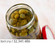 Купить «Pickled capers in glass jar», фото № 32341486, снято 12 декабря 2019 г. (c) Яков Филимонов / Фотобанк Лори