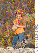 Купить «Девочка в венке из осенних листьев с букетом в руках», фото № 32342002, снято 26 октября 2019 г. (c) WalDeMarus / Фотобанк Лори